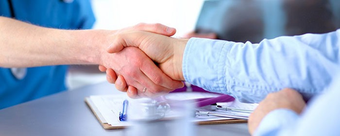 doctor and patient shaking hands - chronic care management companies